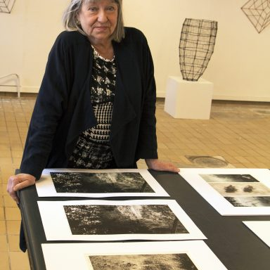 Gunnel Oldenmark poses with her sculptures and graphic works.