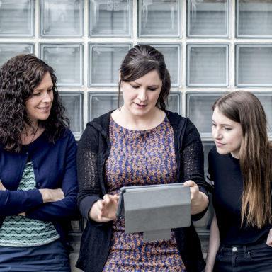Visual News Desk Team with iPad