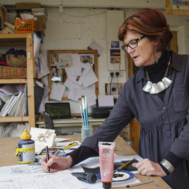 Frances Crowe at work, designing in studio